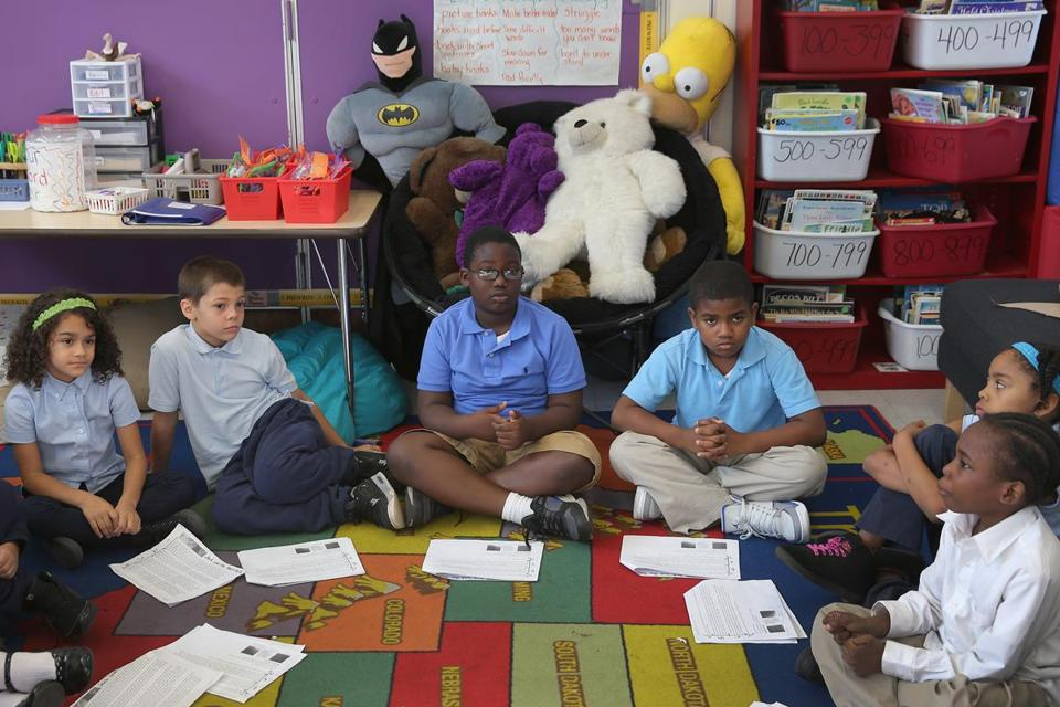 "Third-graders take part in a class discussion known as ""accountable talk."" A big part of the Trotter School's turnaround success has been getting students to think critically."