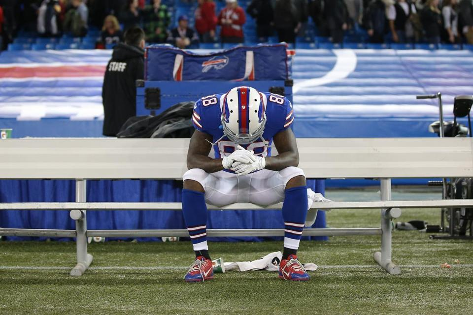 Receiver Marquise Goodwin hangs his head after victory escaped the Bills yet again.