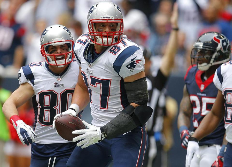 Danny Amendola, left, celebrated after Rob Gronkowski scored a first quarter touchdown.