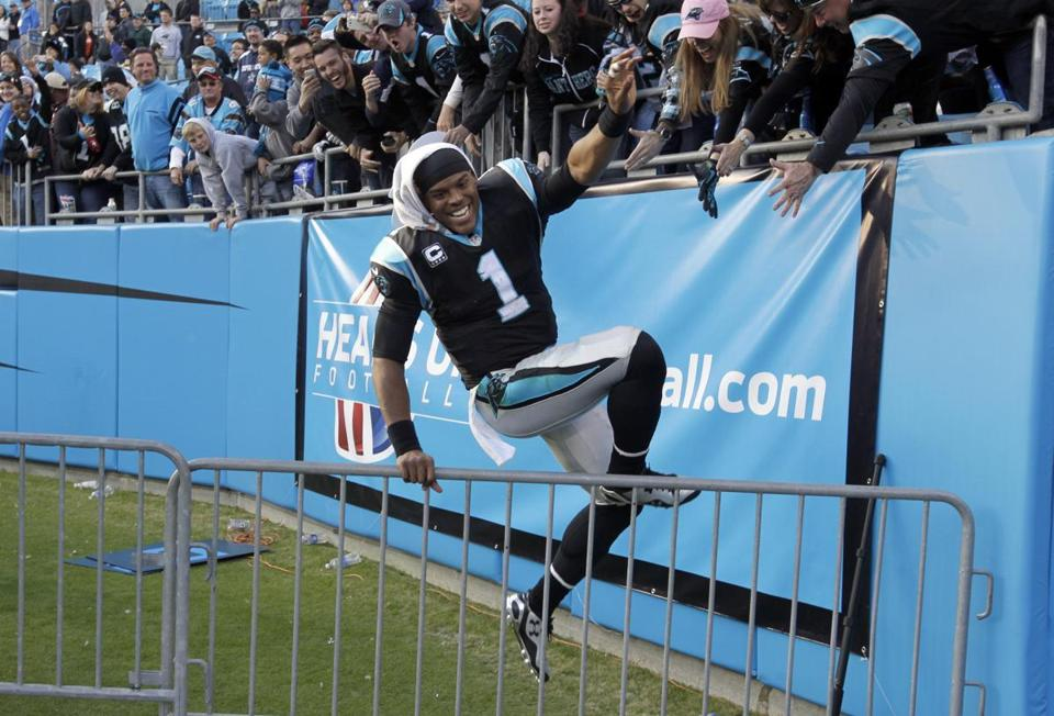 Cam Newton celebrated with Carolina fans after the Panthers won their eighth consecutive game.