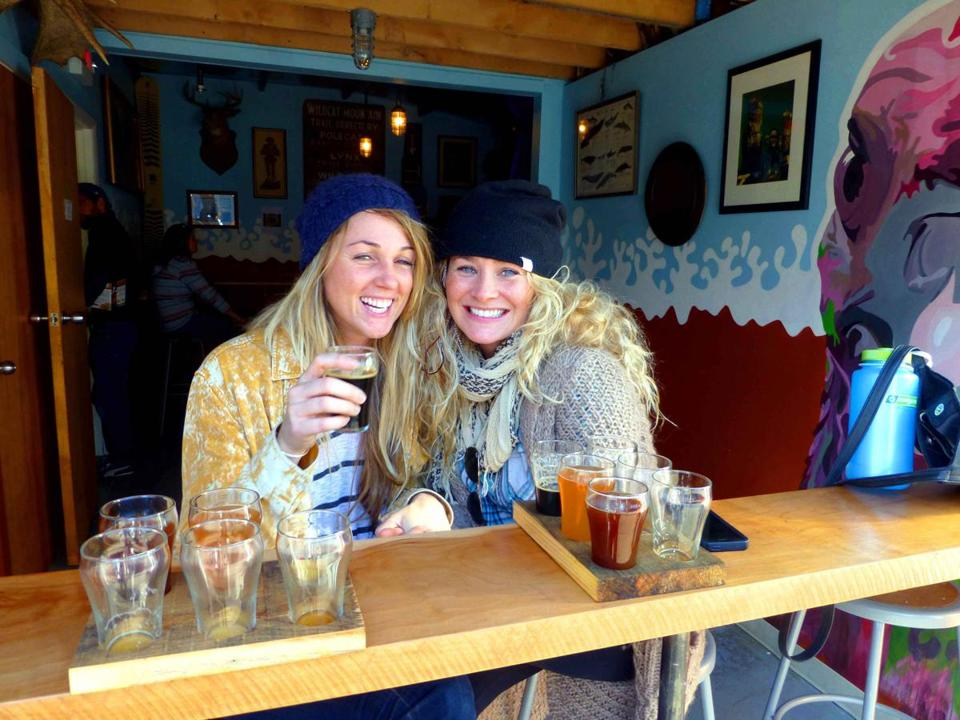Kelly Barry, left, and Jessica Howard taste their way through the offerings at Earth Eagle Brewings in Portsmouth.