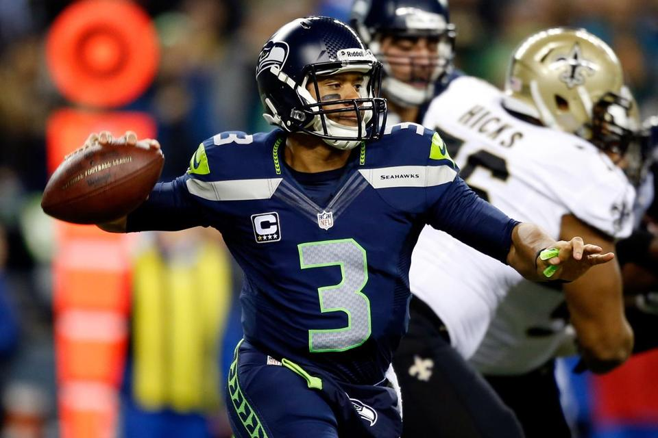 Seahawks quarterback Russell Wilson threw for 310 yards and three touchdowns against the Saints.