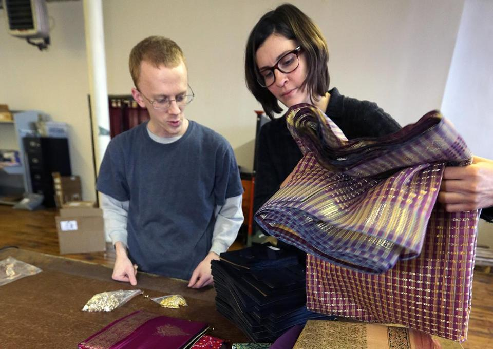 Fabric cutter Mark Currie and Brenna Schneider, cofounder and chief executive of 99 degrees custom, looked over patterns at the company's plant in Lawrence.