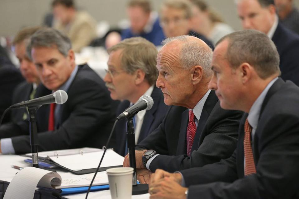 Thomas Reilly, former attorney general, spoke at the microphone for Suffolk Downs to the gaming commission. Allowing Mohegan Sun to pursue a new proposal at a new site on the Suffolk Downs property would preserve a sense of competition for the state's most lucrative gambling license.