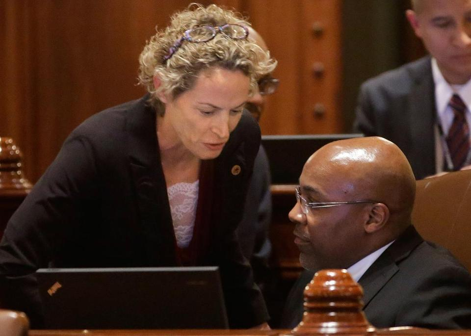 Representative Elaine Nekritz and Senator Kwame Raoul, both Illinois Democrats, after pension legislation passed.