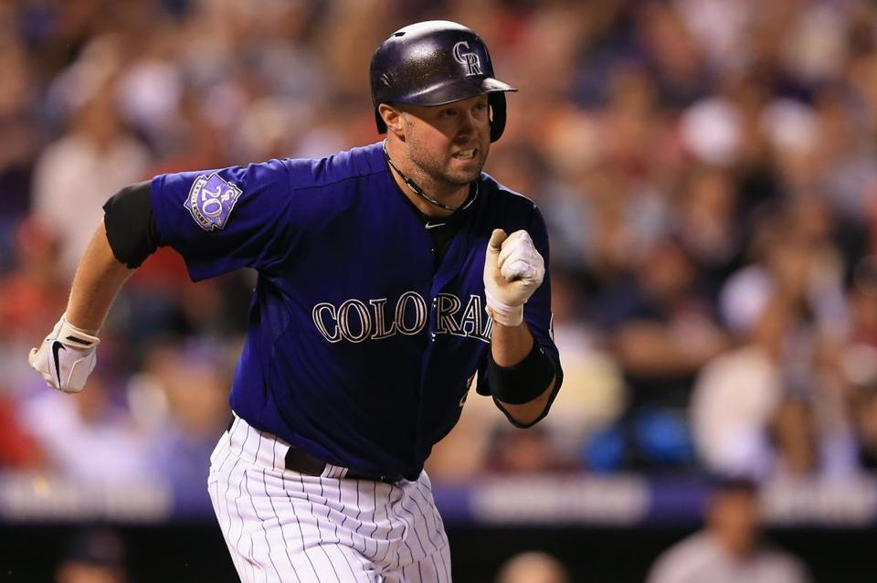 DENVER, CO - SEPTEMBER 24: Michael Cuddyer #3 of the Colorado Rockies runs to first on his two RBI single off of Brandon Workman #67 of the Boston Red Sox in the seventh inning at Coors Field on September 24, 2013 in Denver, Colorado. (Photo by Doug Pensinger/Getty Images)