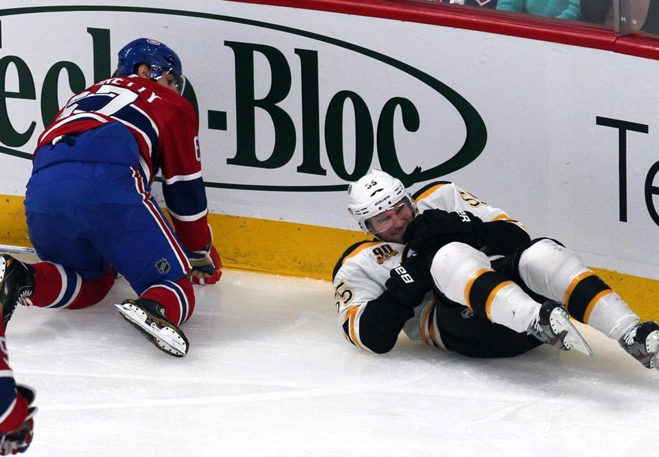 Bruins defenseman Johnny Boychuk was in extreme pain after being checked by the Canadiens' Max Pacioretty in the first period.
