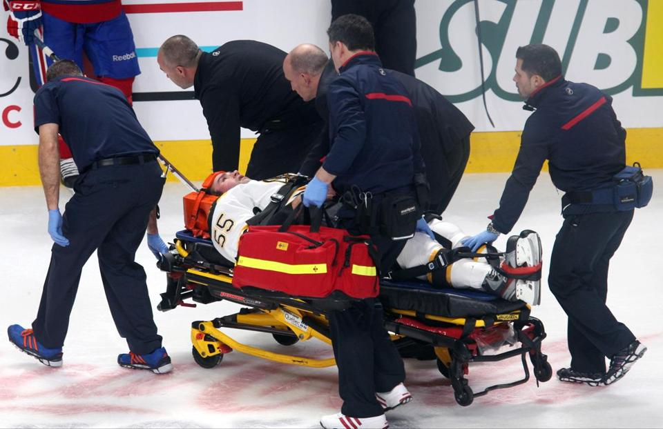 Johnny Boychuk was removed from the ice on a stretcher after he was checked into the boards by Max Pacioretty in the first period.