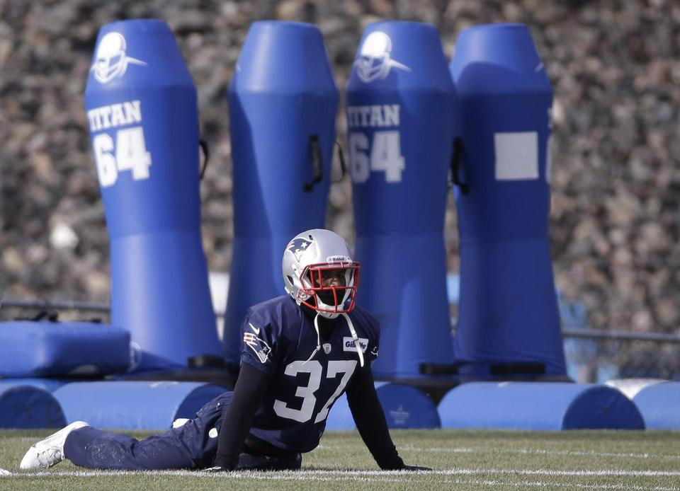 Alfonzo Dennard stretched before practice Wednesday in Foxborough.