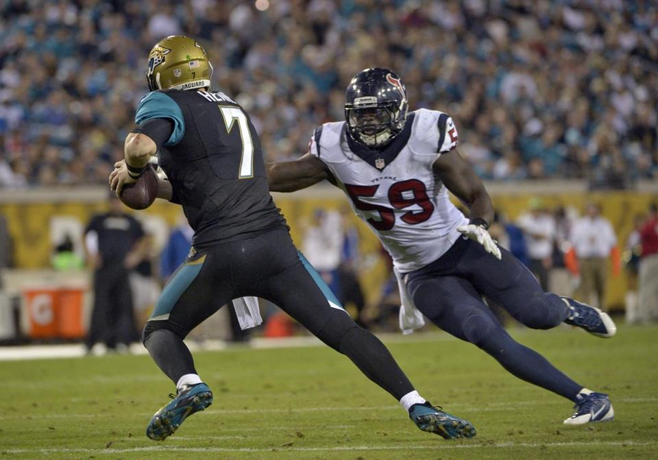 Jaguars quarterback Chad Henne eluded Texans linebacker Whitney Mercilus during Thursday's game in Jacksonville.