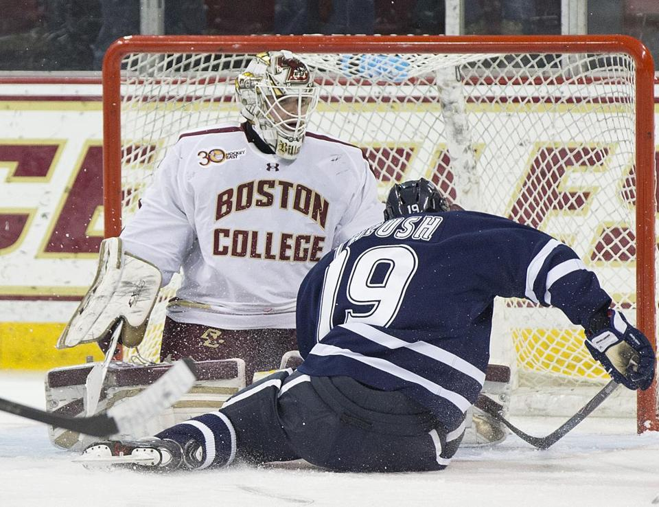 The Eagles' Brian Billett, who had 39 saves, got down to Casey Thrush's level to stop this shot in the first period.
