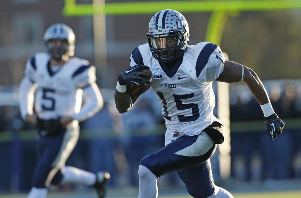 New Hampshire's R.J. Harris ran after a reception during the first half Saturday.