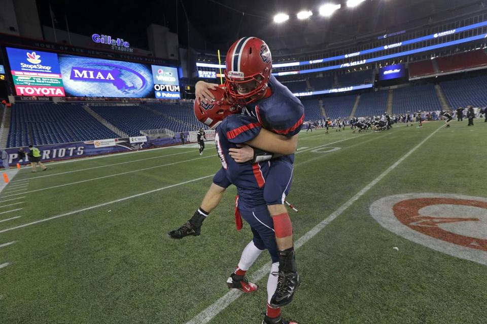 Central Catholic's long road to the Division 1 championship ended at Gillette Stadium, where Nicholas Boes lifted Mike Milano after the win.