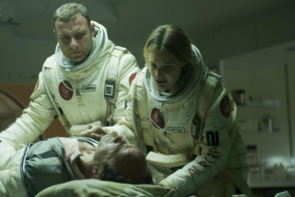 "Liev Schreiber (left), Elias Koteas, and Romola Garai in the low-budget sci-fi thriller ""The Last Days on Mars."""