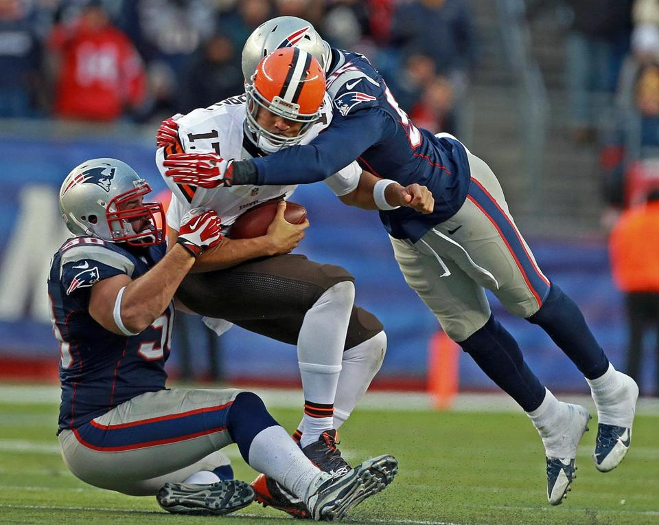 Rob Ninkovich (50) and Chandler Jones (95) combined to sack Browns quarterback Jason Cambell Dec. 8.