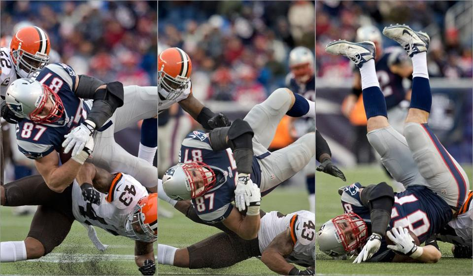 Browns strong safety T.J. Ward (43) goes low to bring down Rob Gronkowski in the third quarter; the Patriots star tight end might have suffered a torn knee ligament on the play.