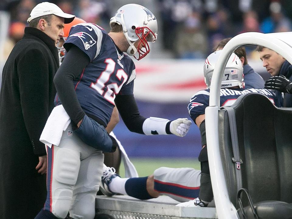 Tom Brady, who has had his own major knee injury, has a pat for Rob Gronkowski as he's carted off the field Sunday.