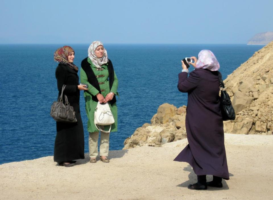 Three tourists captured the moment at an overlook along the Jordanian coastline of the Dead Sea.