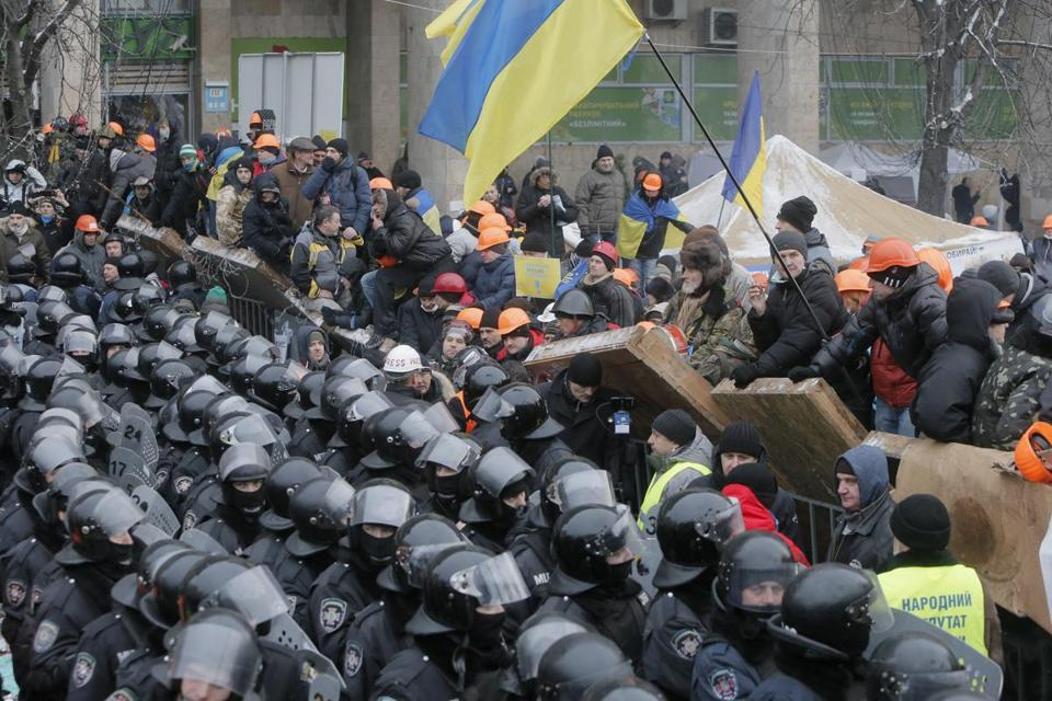 Pro-European Union activists guarded a barricade during clashes with riot police in Independence Square in Kiev, Ukraine