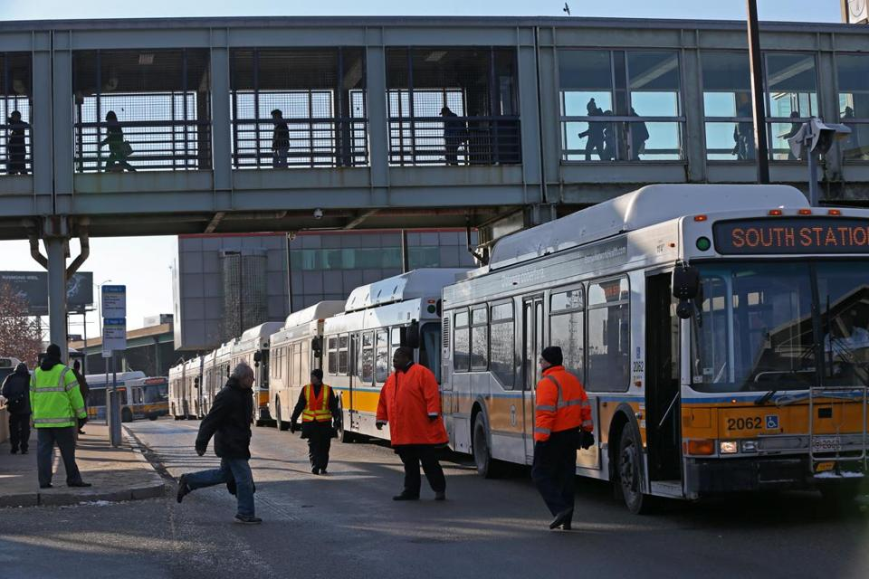 The MBTA brought in buses to serve riders at the JFK station after cracks in the third rail caused by cold weather brought train service to a halt.