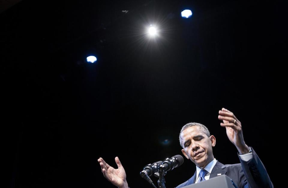 President Barack Obama reacted to applause at the Town Hall Education Arts Recreation Campus.