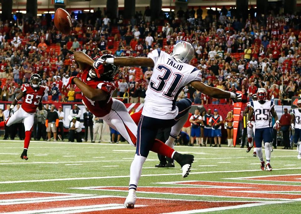 Patriot Aqib Talib has been a shut-down corner: this terrific pass break-up against the Falcons' Roddy White saved the game in the final seconds.