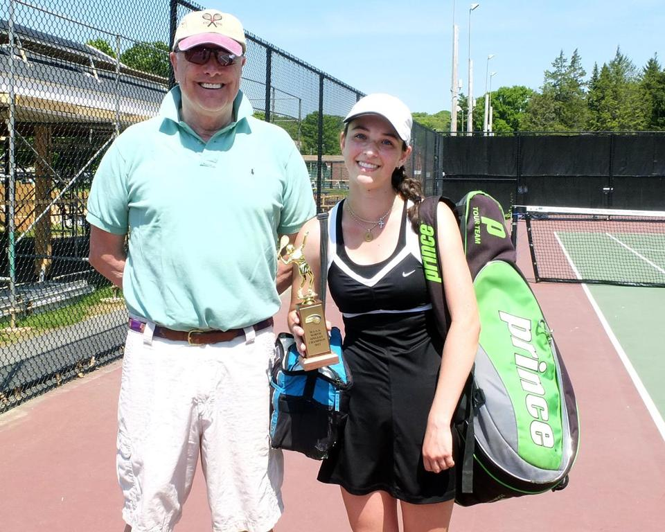 Concord-Carlisle coach Bob Furey stands with his MIAA North singles champion Julia Cancio following her two-set victory.
