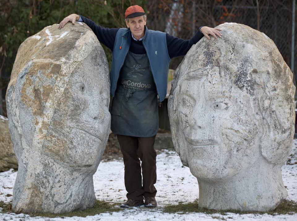 "Mr. Wheelwright stood next to one of his granite pieces, ""Loving Stones,"" outside his studio in 2013."