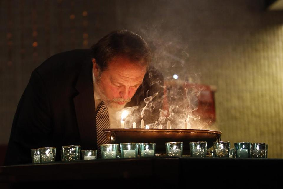 The Rev. Stephen Kendrick blew out candles at First Church Boston, where people gathered to remember Newtown.