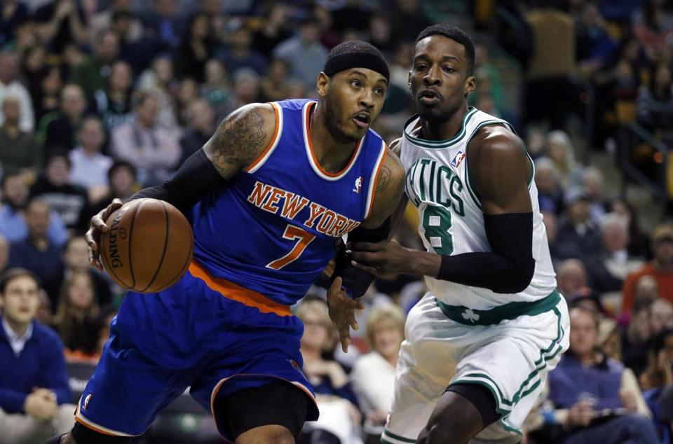 Carmelo Anthony (left) hit just one of his eight field-goal attempts in the fourth quarter, thanks in part to Jeff Green's defense.