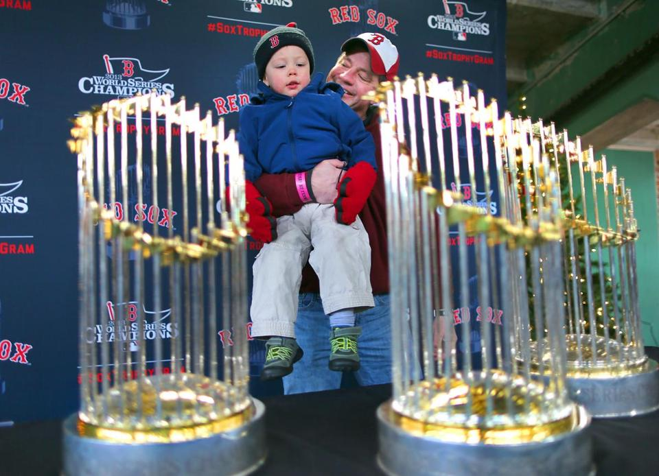David Rafus of Marblehead and son Deacon, 2, share a prized viewing at Fenway Saturday.