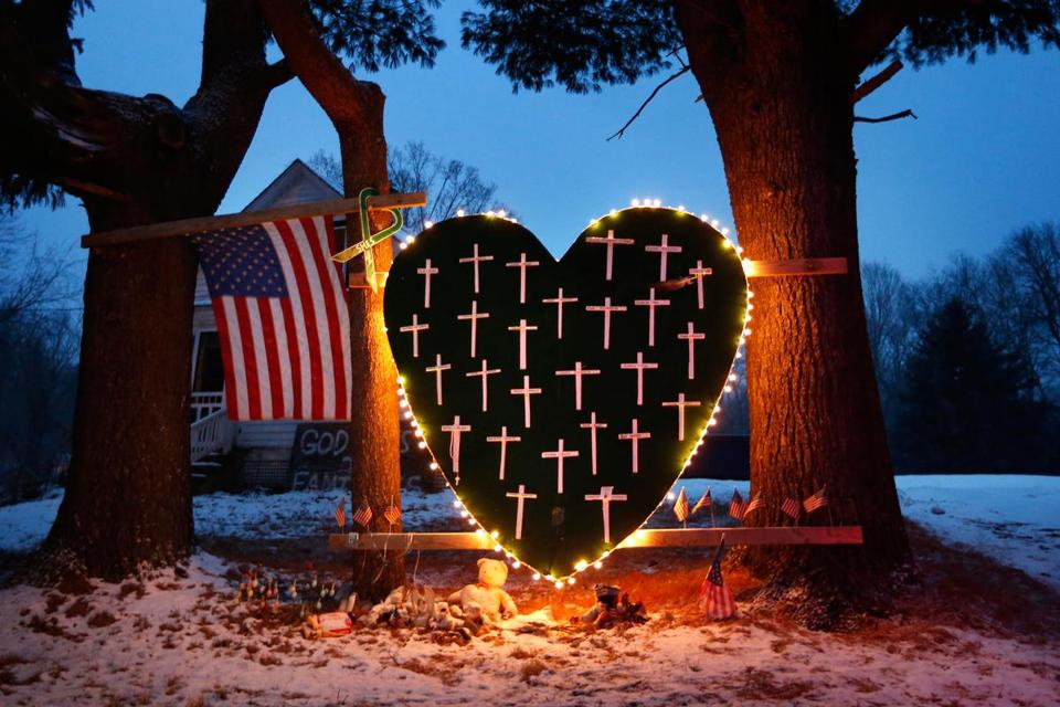 A memorial to the Sandy Hook victims hung in Newtown, where local officials asked for privacy on the anniversary.