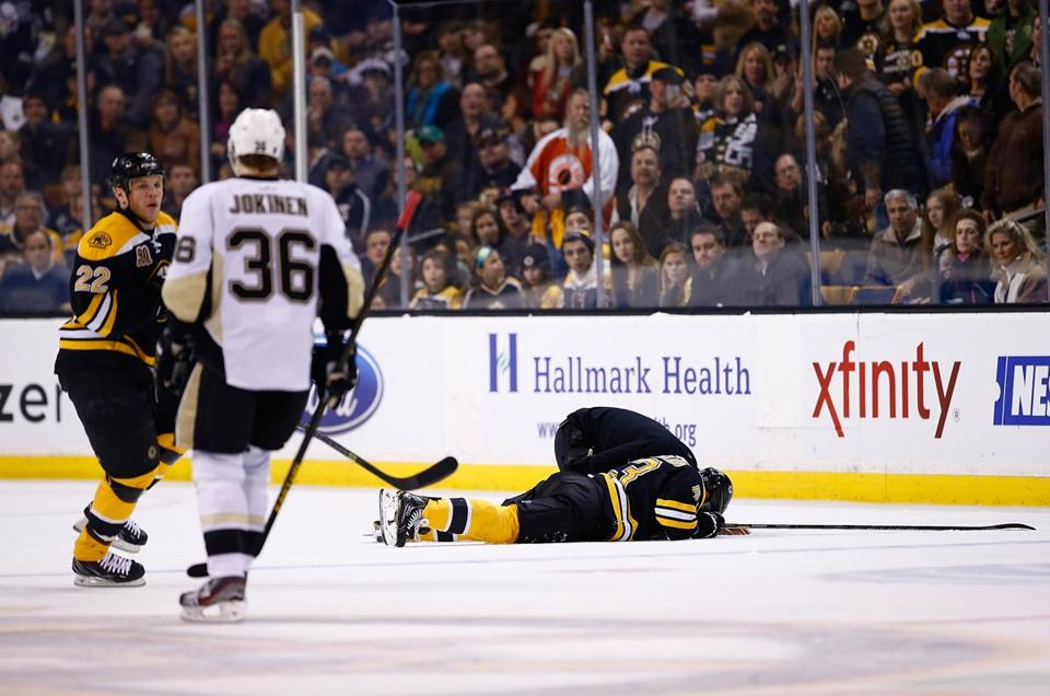Brad Marchand lay on the ice after getting kneed in the head during a Dec. 7 game against the Penguins.