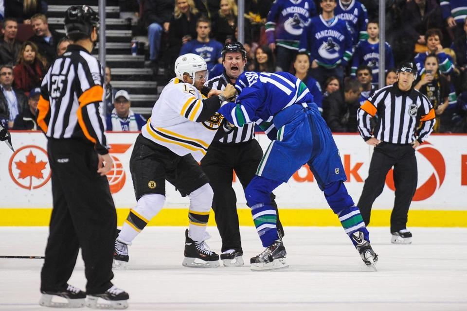 Jarome Iginla had two fights in Saturday's game, including this one with Ryan Kesler.