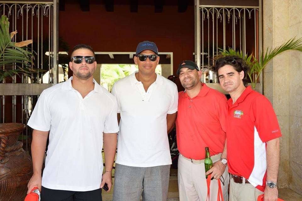"Alex Rodriguez (second from left), among the many stars in attendance at David Ortiz's charity event in the Dominican Republic, said he's ""optimistic"" after the arbitration hearing for his 211-game suspension."