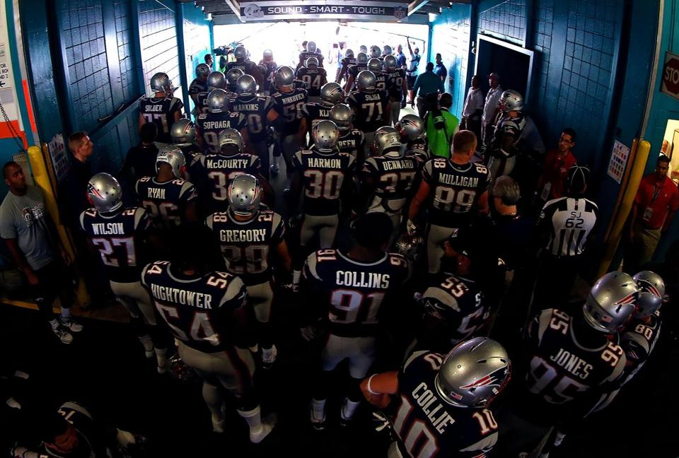 The Patriots waited to take the field in Miami on Sunday.