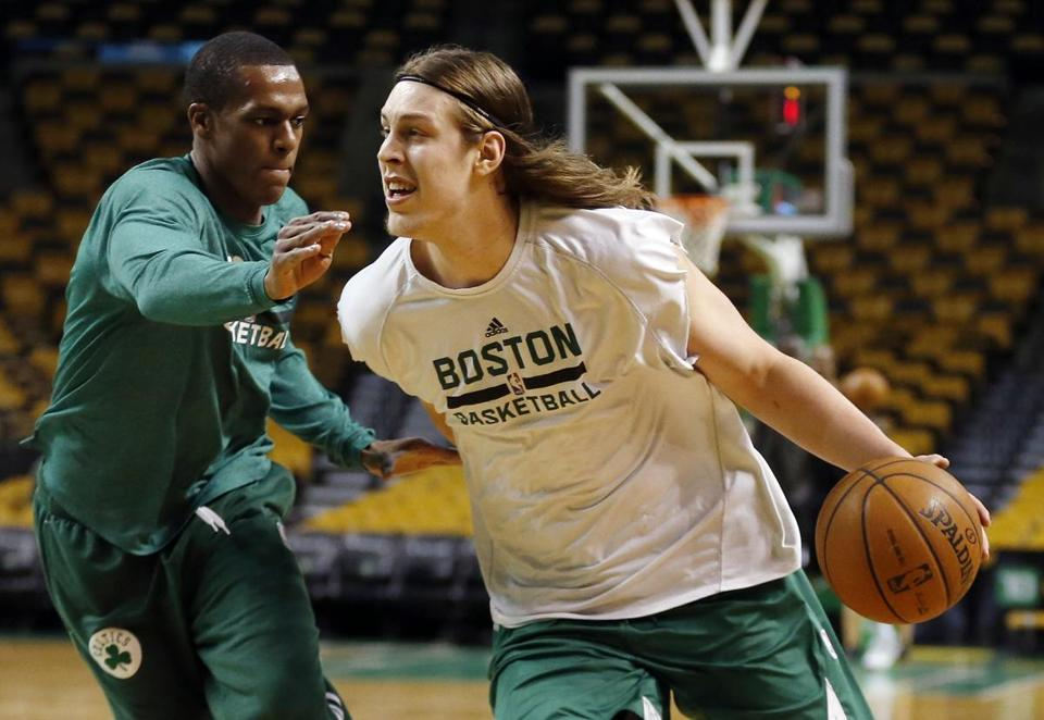 Big man Kelly Olynyk (right) works out with Rajon Rondo before Monday night's game.