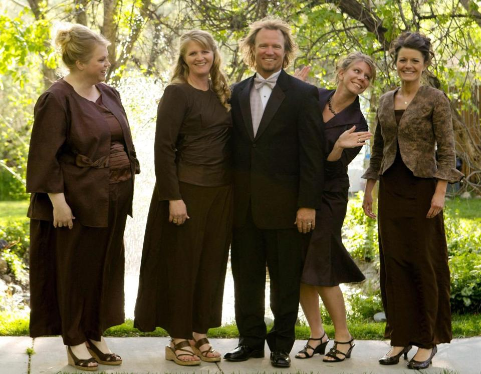 "Kody Brown, center, posed with his wives, from left, Janelle, Christine, Meri, and Robyn in a promotional photo for TLC's reality TV show, ""Sister Wives."""