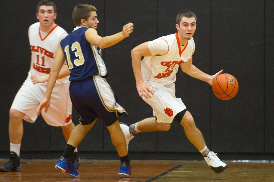 Junior point guard Ryan Carney moved the ball with confidence during game action against Foxborough last week.