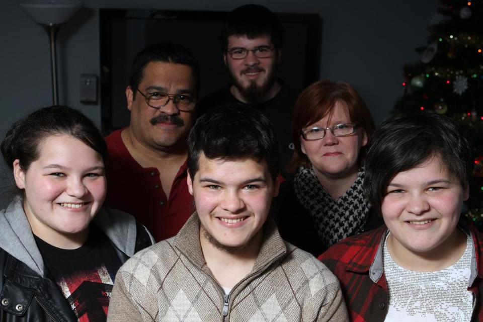 Zachary Kerr (front, center) with his triplet sisters, Amy (left) and Sara; father, Gary; brother Tim; and mother, Grace.