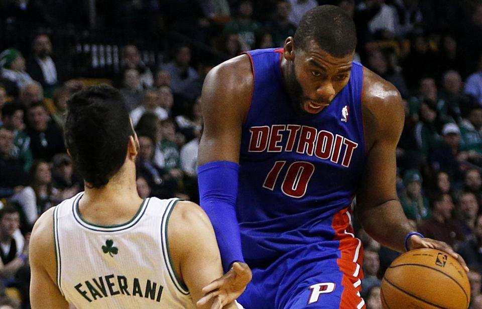 Pistons forward Greg Monroe was called for a charge on Celtics center Vitor Faverani in the third quarter.
