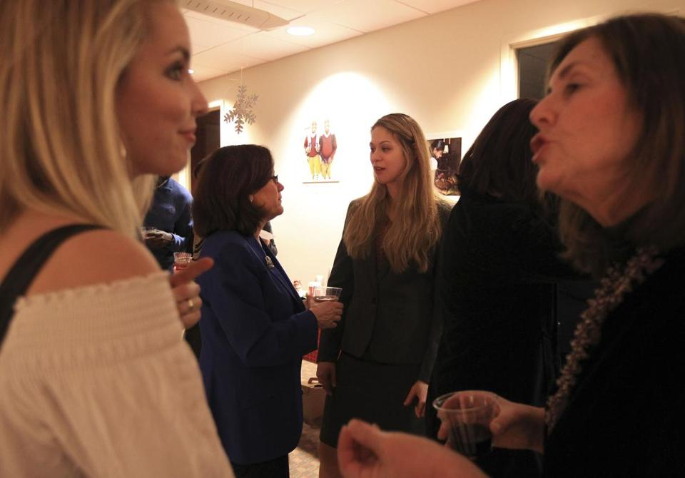 Marla Felcher (center left) spoke with legal counsel Christina Frangos (center right) at a recent Philanthropy Connection event.