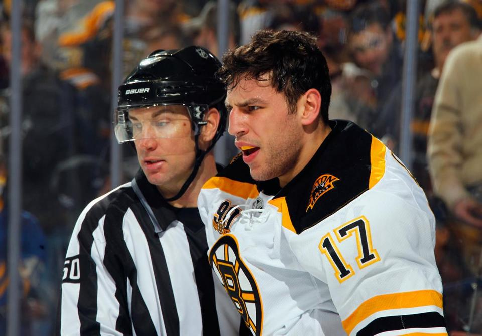 Milan Lucic and Buffalo's Mike Weber (not pictured) tangled early on.