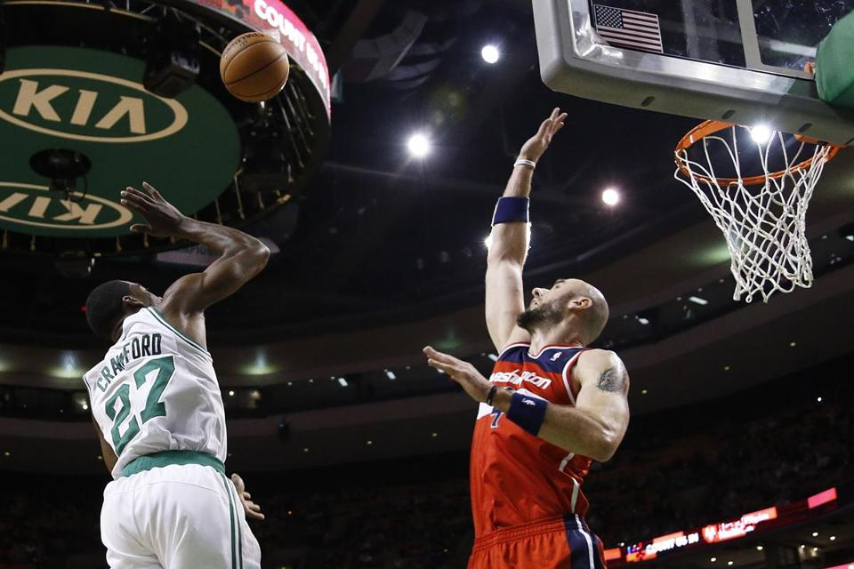 Celtics guard Jordan Crawford shot and made a floater over Wizards center Marcin Gortat in the 1st quarter.