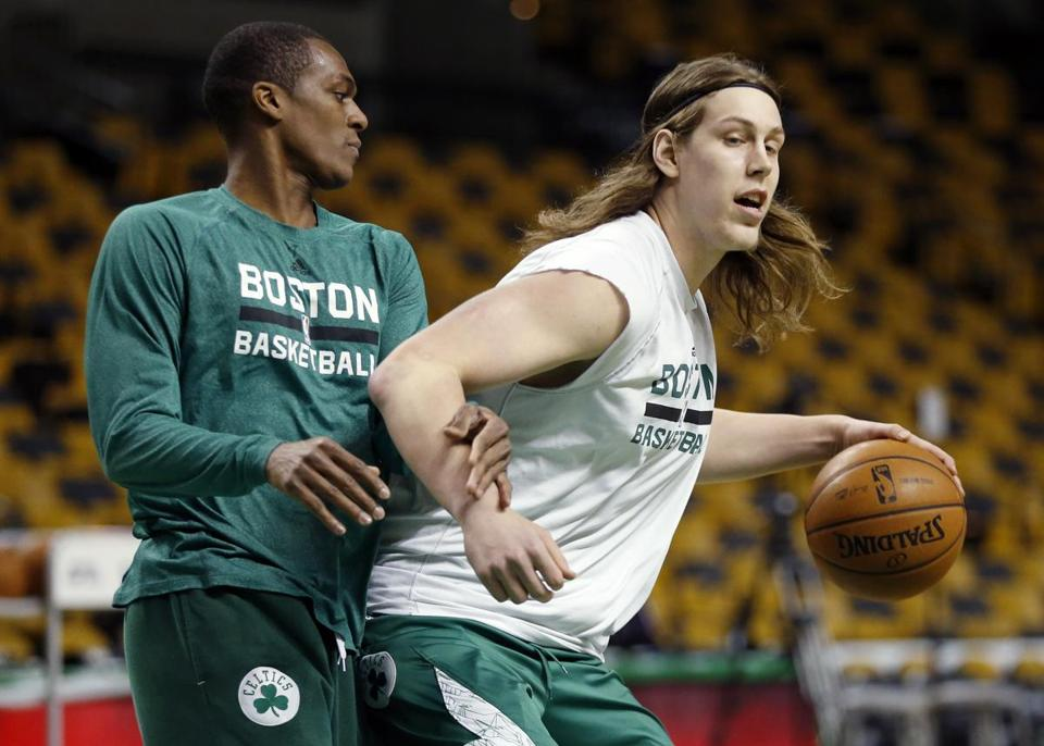 Rajon Rondo, shown guarding Kelly Olynyk during a workout before Monday's game at the Garden, ran the floor with teammates in an impromptu scrimmage Friday.