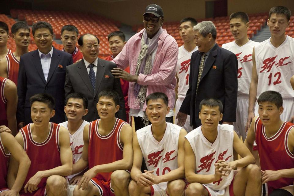 Former NBA basketball star Dennis Rodman posed for pictures with North Korean basketball players and government officials on Friday during a practice in Pyongyang, North Korea.