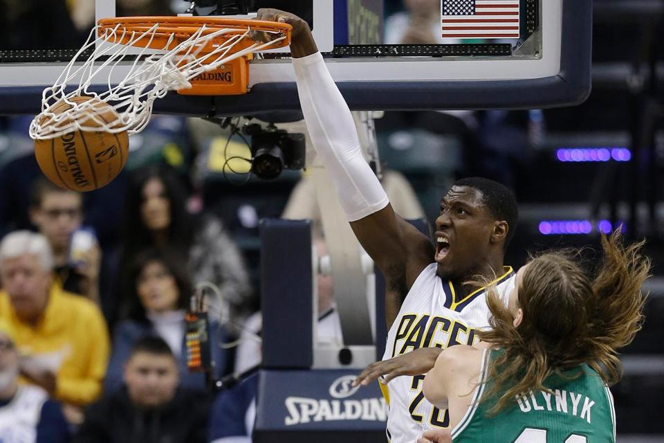 Ian Mahinmi jams home 2 points with authority over Kelly Olynyk in the same way the Pacers slam dunked the Celtics from beginning to end.