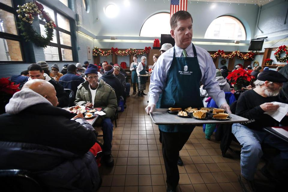Boston Mayor-elect Martin J. Walsh served pumpkin pie during a luncheon for homeless guests at the Pine Street Inn on Christmas Eve.