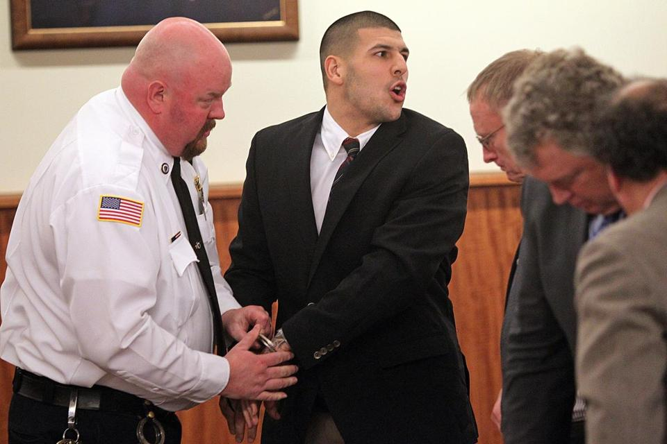 Aaron Hernandez mouthed words to family members after he appeared in court at the Fall River Justice Center on Monday.
