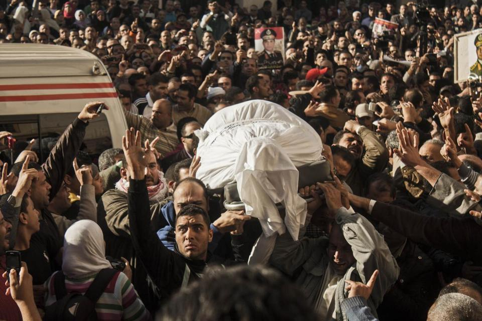 Egyptians carried the coffin of a victim killed in the explosion at a police headquarters during a funeral in the Nile Delta city of Mansoura on Tuesday. Egypt has seen an escalating campaign of spectacular bombings, drive-by shootings, assassinations, and mass killings.